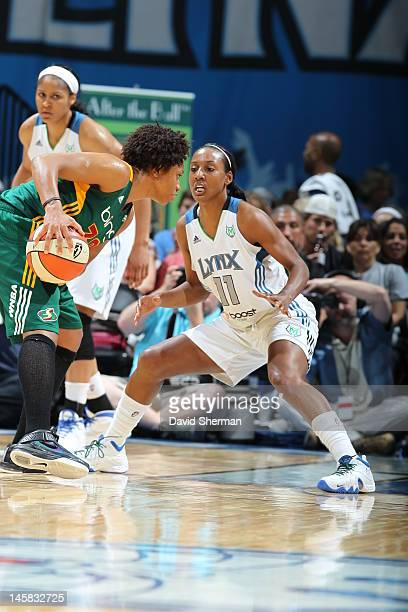 Tanisha Wright of the Seattle Storm looks to pass the ball against Candice Wiggins of the Minnesota Lynx 1in the game on June 6 2012 at Target Center...