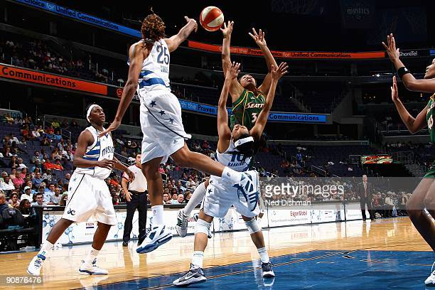 Tanisha Wright of the Seattle Storm loses control of the ball against Lindsey Harding, Monique Currie and Crystal Langhorne of the Washington Mystics...