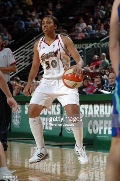 Tanisha Wright of the Seattle Storm moves the ball during the WNBA game against the New York Liberty on July 1 2007 at the KeyArena in Seattle...