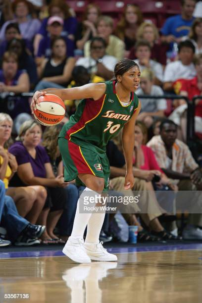Tanisha Wright of the Seattle Storm readies for the play against the Sacramento Monarchs during a game on August 20 2005 at Arco Arena in Sacramento...