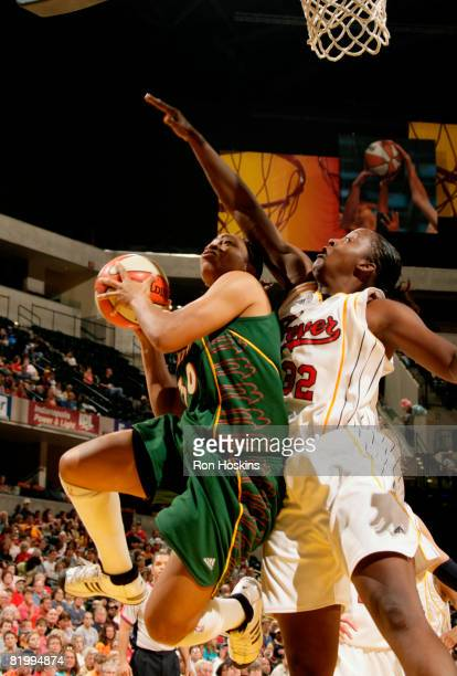 Tanisha Wright of the Seattle Storm shoots around Ebony Hoffman of the Indiana Fever at Conseco Fieldhouse on July 18 2008 in Indianapolis Indiana...