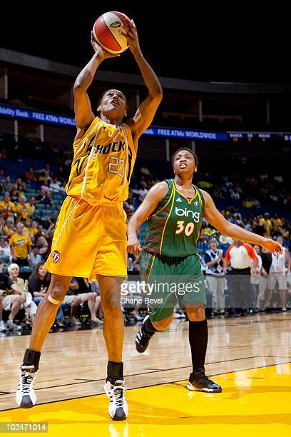 Tanisha Wright of the Seattle Storm watches as Marion Jones of the Tulsa Shock puts away a last minute shot at the end of the half during the WNBA...