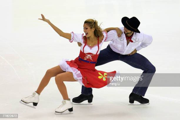 Tanith Belbin and Benjamin Agosto of USA skate in the Ice Dancing Original Dance during the Cup of China Figure Skating competition which is part of...
