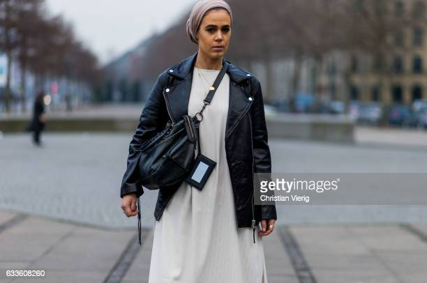 Tanja Ayesha wearing a white dress black leather jacket hand bag loafers during the Copenhagen Fashion Week Autumn/Winter 17 on February 2 2017 in...