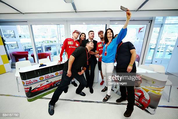 Tanja Bauer Sky F1 Germany takes a selfie with Kimi Raikkonen of Finland and Ferrari Sebastian Vettel of Germany and Ferrari Federica Masolin and...