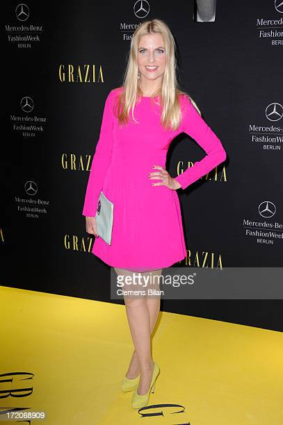 Tanja Buelter attends the MercedesBenz Fashion Week Berlin Spring/Summer 2014 Preview Show by Grazia at the Brandenburg Gate on July 1 2013 in Berlin...