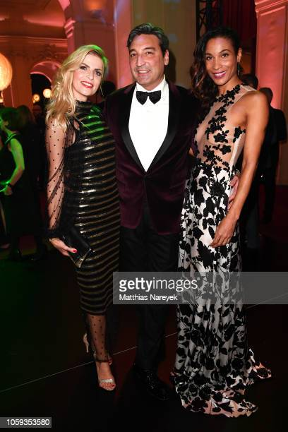 Tanja Buelter DJ Mousse T and Annabelle Mandeng attend the GQ Men of the Year Award after show party at Komische Oper on November 8 2018 in Berlin...