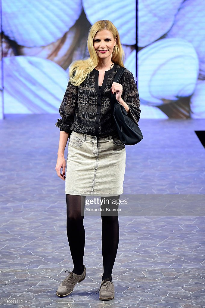Tanja Buelter (C) walks the runway during the Ernsting's family Fashion Show Autumn/Winter 2015 at Hotel Atlantic on July 16, 2015 in Hamburg, Germany.