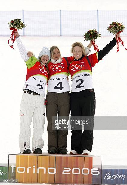 Tanja Frieden of Switzerland celebrates her gold medal with silver medallist Lindsey Jacobellis and bronze medallist Dominique Maltais of Canada in...
