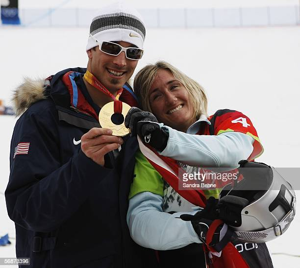 Tanja Frieden of Switzerland celebrates with gold medal winner Seth Wescott of the United States after the Womens Snowboard Cross Final on Day 7 of...