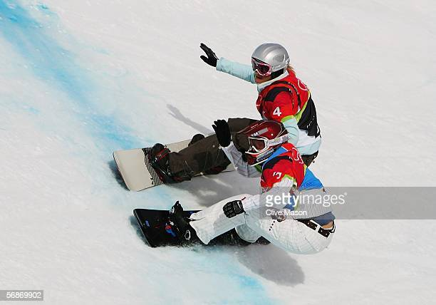 Tanja Frieden of Switzerland tries to overtake Lindsey Jacobellis of the United States in the Womens Snowboard Cross Final on Day 7 of the 2006 Turin...