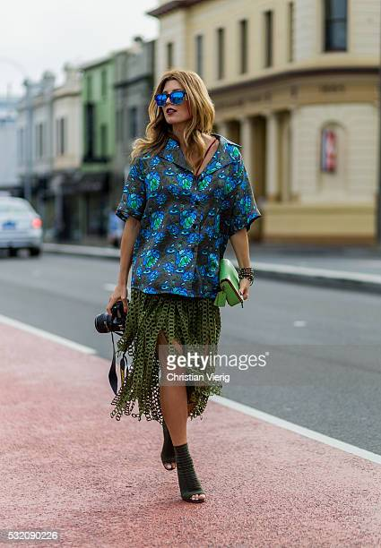 Tanja Gacic wearing a Romance Was Born button shirt an olive Coach skirt and Ginavito Rossi peep toes heels outside Kitx at MercedesBenz Fashion Week...