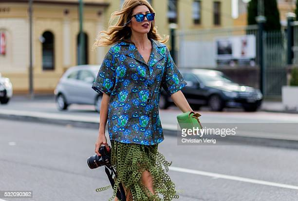 Tanja Gacic wearing a Romance Was Born button shirt an olive Coach skirt outside Kitx at MercedesBenz Fashion Week Resort 17 Collections at...