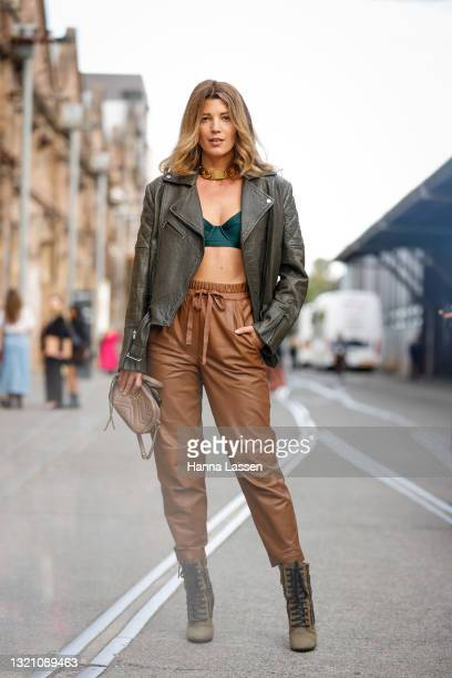 Tanja Gacic wearing a vintage Celine necklace, Ginger and Smart jacket and pants, Balmain boots, Gucci bag at Afterpay Australian Fashion Week 2021...