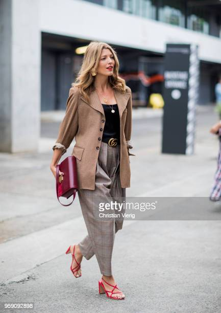 Tanja Gacic wearing brown wool jacket grey pants Gucci belt during MercedesBenz Fashion Week Resort 19 Collections at Carriageworks on May 16 2018 in...