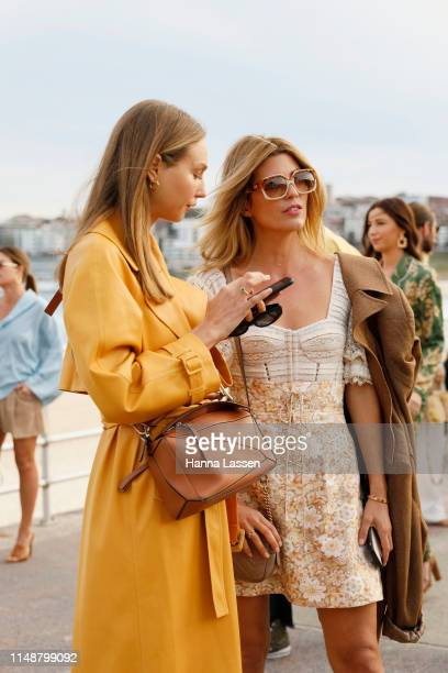 Tanja Gacic wearing white lace dress leather boots and Gucci bag at MercedesBenz Fashion Week Resort 20 Collections on May 13 2019 in Sydney Australia