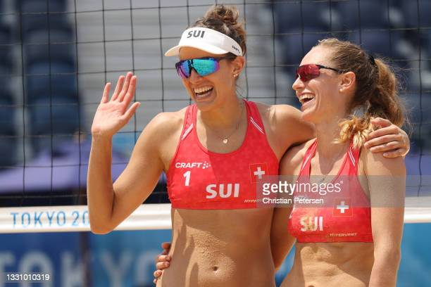 Tanja Huberli of Team Switzerland and Nina Betschart celebrate after defeating Team Japan during the Women's Preliminary Round - Pool F beach...