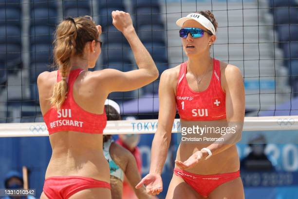 Tanja Huberli of Team Switzerland and Nina Betschart celebrate after a point against Team Japan during the Women's Preliminary Round - Pool F beach...