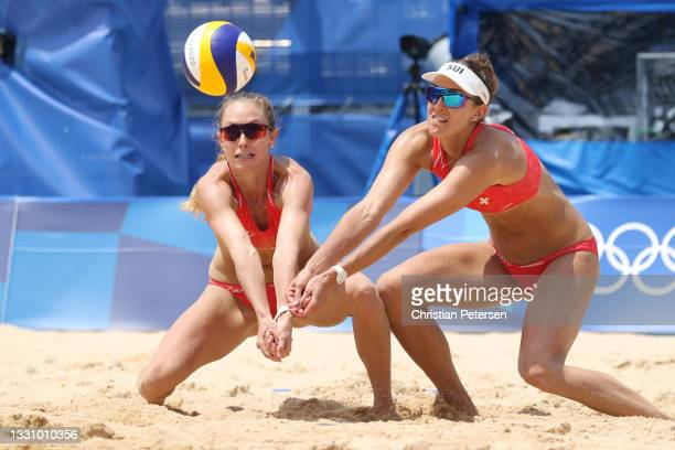 Tanja Huberli of Team Switzerland and Nina Betschart return against Team Japan during the Women's Preliminary Round - Pool F beach volleyball on day...