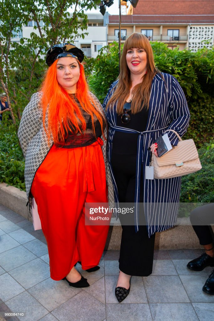 Tanja Marfo (R) and guest attend the Marcel Ostertag Fashion Show during the Berlin Fashion Week Spring/Summer 2019 in Berlin, Germany on July 4, 2018.