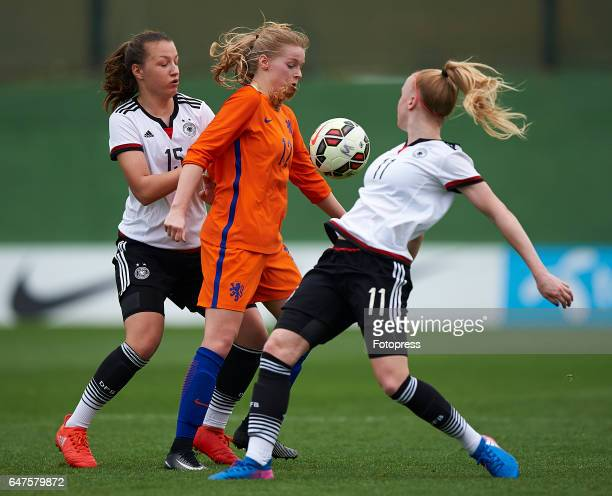 Tanja Pawollek and Anna Gerhardt of Germany competes for the ball with Nadine Noordam of Netherlands during the international friendly match between...