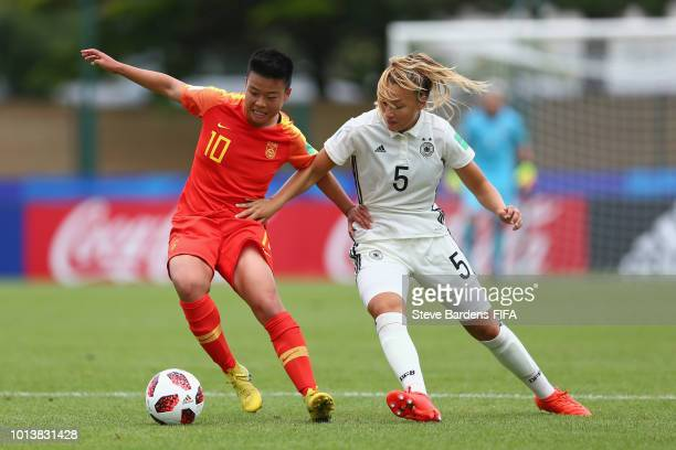 Tanja Pawollek of Germany challenges for the ball with Yujie Zhao of China PR during the FIFA U20 Women's World Cup France 2018 group D match between...