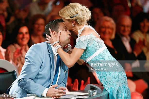 Tanja Szewczenko kisses jury member Joachim Llambi during the 5th show of 'Let's Dance' on RTL at Coloneum on May 2, 2014 in Cologne, Germany.