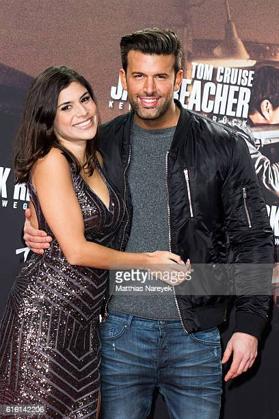 Tanja Tischewitsch and Jay Khan attend the 'Jack Reacher Never Go Back' Berlin Premiere at CineStar Sony Center on October 21 2016 in Berlin Germany