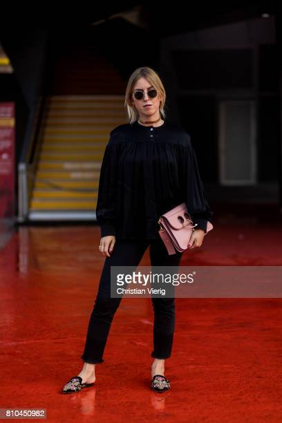 Tanja Trutschnig wearing black blouse denim jeans slippers pink JW Anderson bag outside Marina Hoermanseder during the MercedesBenz Fashion Week...