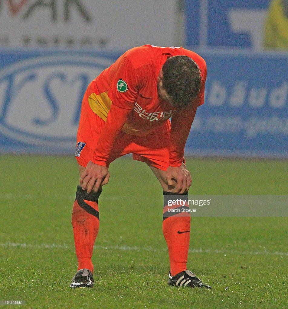 Tanju Oeztuerk of Duisburg look dejected during the Third League match between Preussen Muenster and MSV Duisburg at Preussenstadion on December 7, 2013 in Muenster, Germany.
