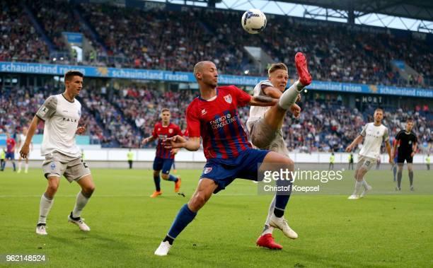 Tanju Oeztuerk of Uerdingen challenges Dorian Diring of Mannheim during the Third League Playoff first leg match between KFC Uerdingen and Waldhof...
