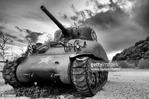 tank against cloudy sky - armored tank stock photos and pictures