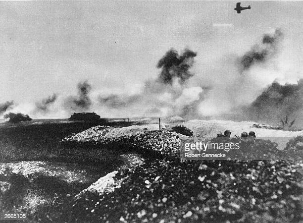 A tank and air battle near Cambrai on the Western Front The heads of German soldiers can be seen in the right foreground