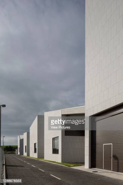 Tank and workshop facades along street. Beaufort Maritime and Energy Research Laboratory, Ringaskiddy, Ireland. Architect: McCullough Mulvin...