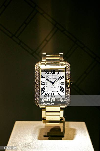 A Tank Anglaise wristwatch by Cartier a watchmaking unit of Cie Financiere Richemont SA sits on display at the Salon International de la Haute...