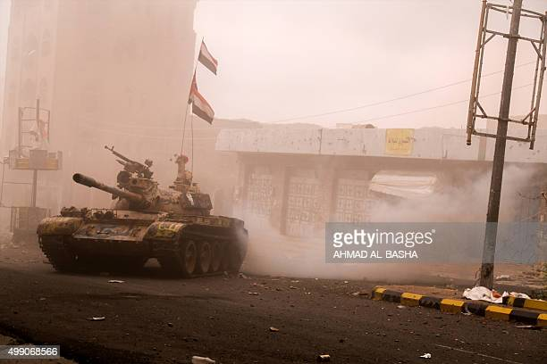 A tank belonging to fighters loyal to Yemeni President Abedrabbo Mansour Hadi is driven through a street on the outskirts of Yemen's third city Taez...