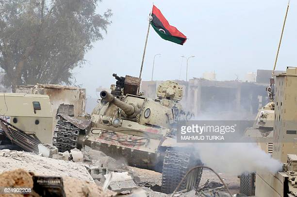 T54 tank belonging to forces loyal to Libya's Government of National Accord takes position in Sirte's AlGiza AlBahriya district on November 21 during...