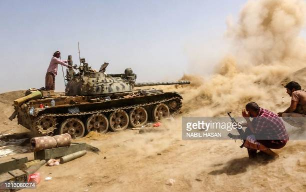 Tank belonging to forces loyal to Yemen's Southern Transitional Council separatists fires while on the frontline of clashes with pro-government...