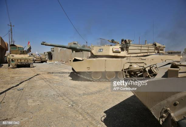 Tank belonging to the Iraqi forces, backed by Shiite fighters from the Popular Mobilization Forces, advances inside al-Nour neighbourhood, in eastern...
