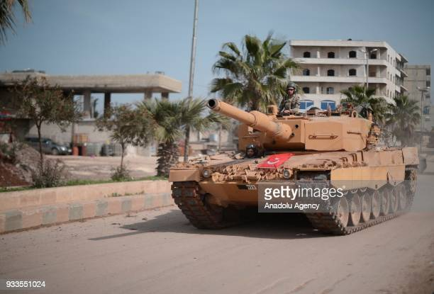 A tank belonging to Turkish army patrols in town center after Turkish Armed Forces and Free Syrian Army took complete control of northwestern Syria's...