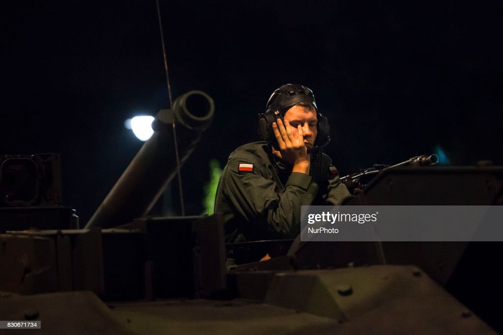 Tank crew member during night training before parade on Polish Army Day in Warsaw on August 12, 2017.