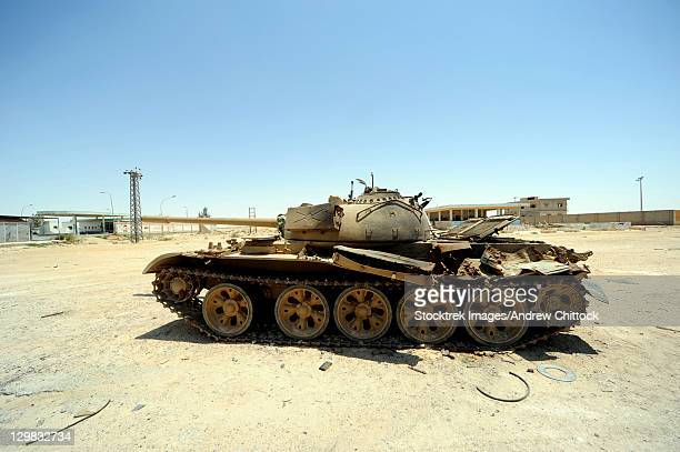 A T-55 tank destroyed by NATO forces in the desert north of Ajadabiya, Libya.