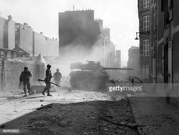 """Tank destroyer is firing its 76MM gun """"point blank"""" at a Nazi bunker location to clear a path through a side street in Brest in September 1944. AFP..."""