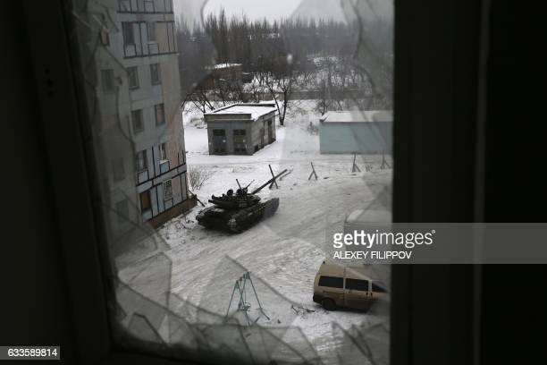 TOPSHOT A tank from the Ukrainian Forces is stationed outside a building in the flashpoint eastern town of Avdiivka that sits just north of the...
