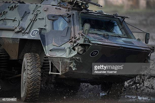 A tank 'Fuchs' of the German Armed Forces shows its skills prior the arrival of German Defense Minister Ursula von der Leyen participating in land...