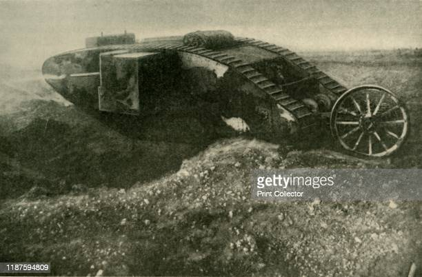 """Tank"""" in Action', First World War, 1914-1918, . '...one of His Majesty's land-ships astride a large shell-hole on the Somme Front'. A British Mark I..."""