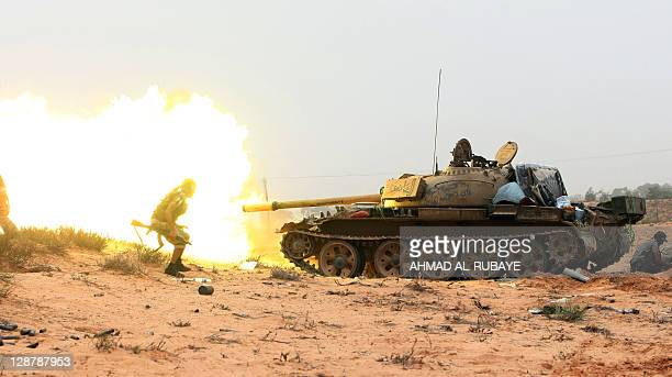 A tank is fired as Libyan fighters loyal to the National Transitional Council battle troops loyal to former leader Moamer Kadhafi in the town of...