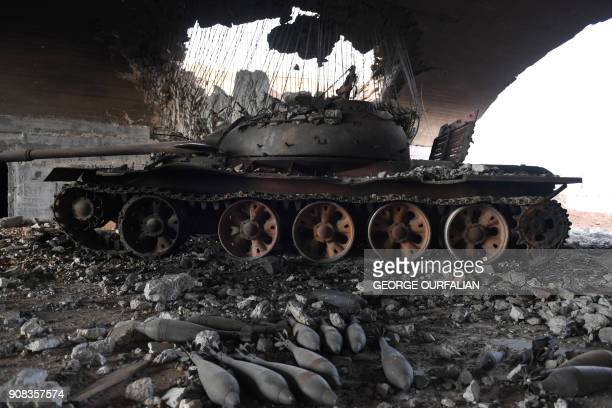 TOPSHOT A tank is seen at the Abu Duhur military airport area in Idlib province on January 21 2018 Syria's army announced it had captured the vital...