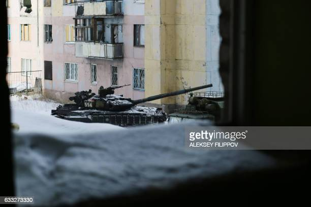 A tank is seen in the Ukrainian town of Avdiivka on February 1 2017 as government forces and Russianbacked separatists exchanged mortar and rocket...