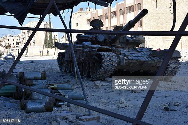 A tank is seen on a street on November 27 2016 in the Masaken Hanano district in eastern Aleppo a day after Syrian progovernment forces resized it...